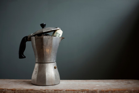 insurance themes: Coffee pot with dollar notes inside