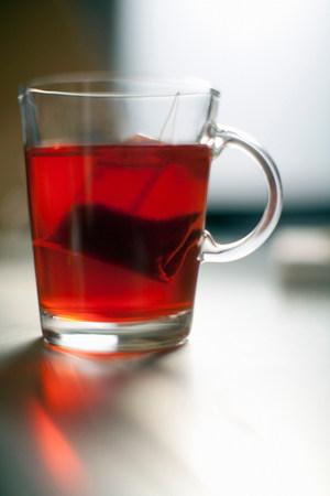 tea breaks: Tea bag steeping in glass mug