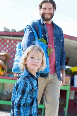 30 years old man: Father and son at farmers market