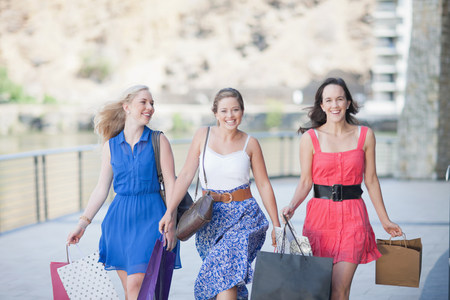 materialism: Three young women with shopping bags