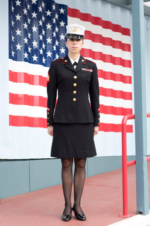 servicewoman: Servicewoman in dress blues by US flag LANG_EVOIMAGES