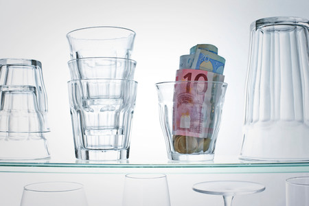 affluent: Euro banknotes in glass on shelf