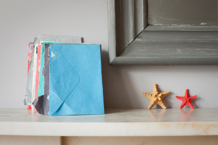 Envelopes and starfish on mantelpiece