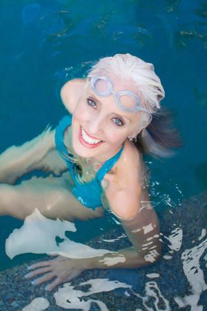 Older woman swimming in pool
