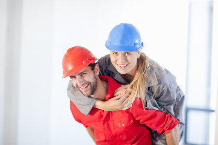 Young couple having fun on construction site