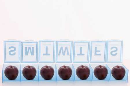 organised: Pill holder containing apples