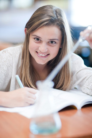 computer science class: School girl enjoying science lesson