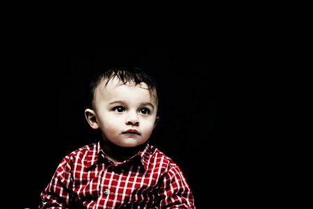 Portrait of baby boy wearing checked shirt LANG_EVOIMAGES
