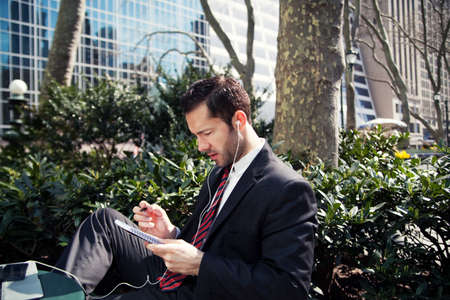electronic music: Businessman working outdoors LANG_EVOIMAGES