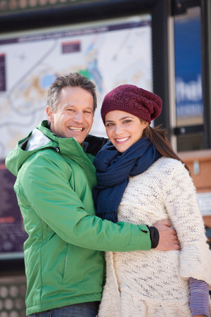 two persons only: Couple in warm clothing smiling,portrait