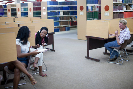 african student: Student in library cubicles