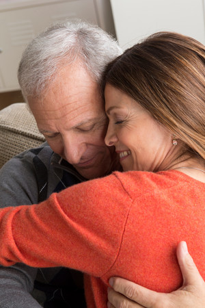 shutting: Mature woman and senior man hugging