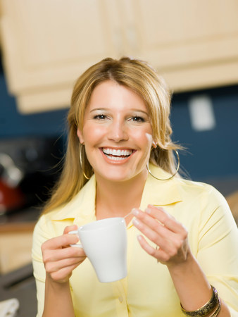 tea breaks: Mid adult woman holding cup and smiling,portrait