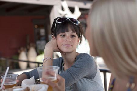 Girlfriends having drinks in outdoor cafe,smiling LANG_EVOIMAGES