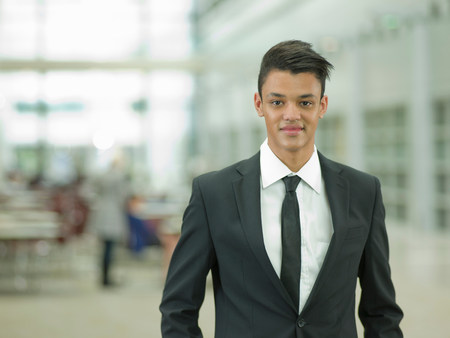 business: Young businessman in black suit,smiling