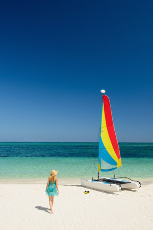 Woman on beach,Grace Bay,Providenciales,Turks and Caicos,Caribbean LANG_EVOIMAGES