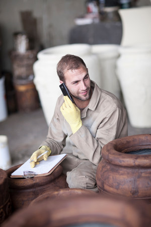 Painting and staining process in pottery factory