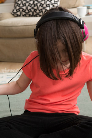 top 7: Girl wearing headphones,looking down