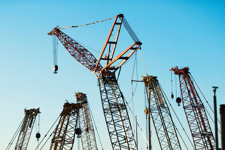 housebuilding: Group of construction cranes LANG_EVOIMAGES