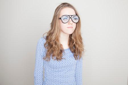 frowns: Girl wearing fake glasses LANG_EVOIMAGES