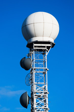Communications tower against blue sky LANG_EVOIMAGES