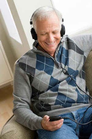 sweatshirts: Senior man wearing headphones listening to music