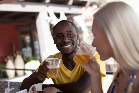 two persons only: Couple enjoying drinks in outdoor cafe,smiling