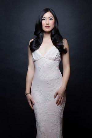 Portrait of woman wearing white dress