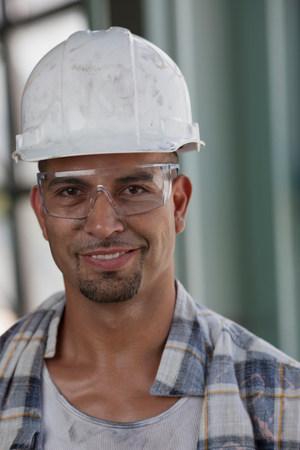 Mid adult construction worker wearing hard hat,portrait LANG_EVOIMAGES