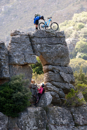 trouble free: Mountain biking couple on rock formation LANG_EVOIMAGES