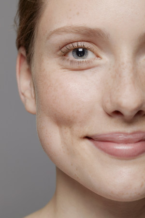 dimple: Close up of part of young womans face,smiling