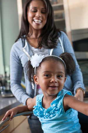 afro caribbean ethnicity: Young girl and mid adult mother,portrait