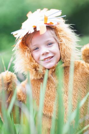 Child wearing lion costume