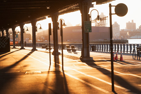 passageways: Cycle and walkway below bridge at sunset  New York City,USA LANG_EVOIMAGES