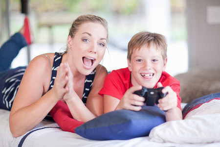 untruth: Woman and boy playing computer games