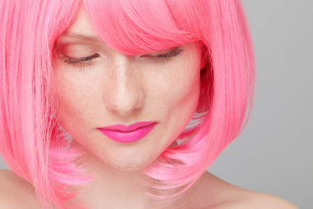 Close up of teenage girl with pink hair LANG_EVOIMAGES