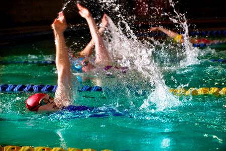 teenaged girl: Female swimmers doing backstroke in swimming pool