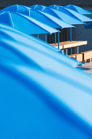 seating area: Picnic tables with blue umbrellas