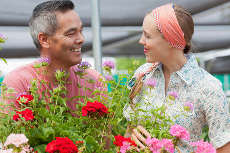 Mature man and mid adult woman shopping in garden centre,smiling LANG_EVOIMAGES