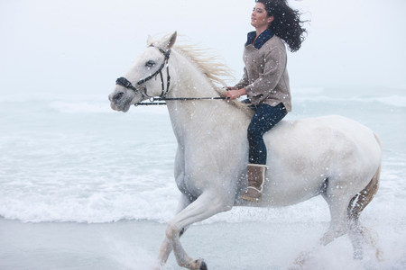 chillout: Woman riding horse on beach