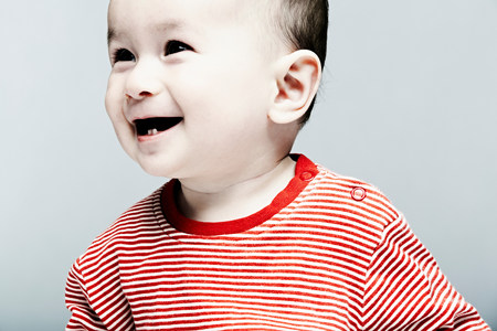 Portrait of baby boy wearing striped top looking away LANG_EVOIMAGES