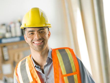 build in: Mid adult construction worker smiling,portrait
