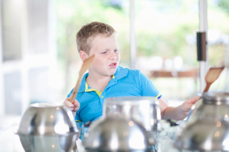 puckered lips: Boy pretending to be drummer