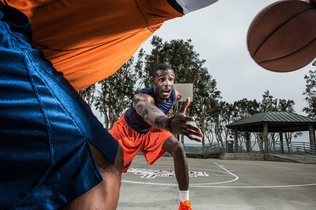 exerting: Young basketball players playing on court,close up LANG_EVOIMAGES
