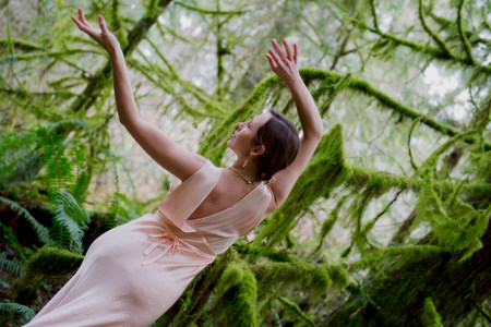 one mature woman only: Mature woman dancing in forest