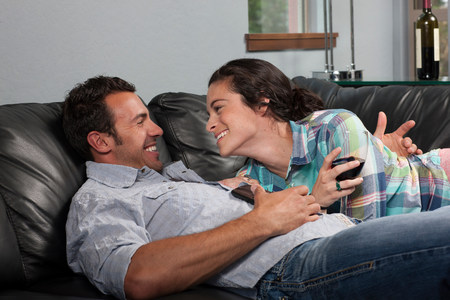 chillout: Young couple relaxing on sofa,smiling