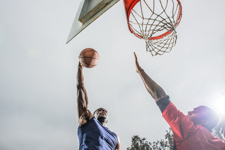 opposed: Young basketball players jumping to score hoop LANG_EVOIMAGES