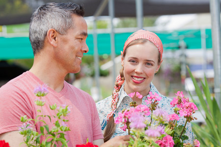 customer facing: Mature man and mid adult woman shopping in garden centre,smiling LANG_EVOIMAGES