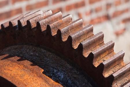 Close up of rusting cogwheel LANG_EVOIMAGES