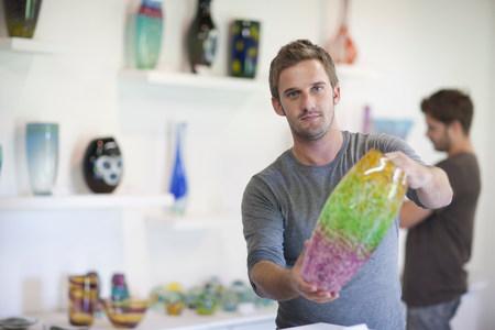 Man holding glass vase LANG_EVOIMAGES
